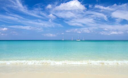 Sea sand sky and soft wave of blue ocean on sandy beach summer day. Background