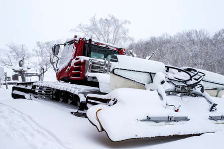 Bulldozer removing snow with blade clears snow after a storn in a residential Zdjęcie Seryjne