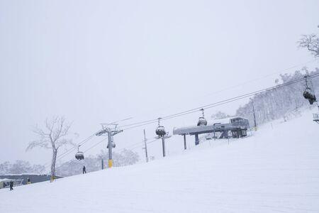 Ski in winter season, mountains and ski equipments on ski run in Hokkaido, Japan
