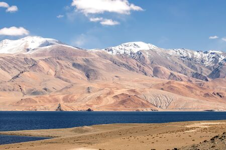 Tso Moriri Lake on clear Sunny day with mountain background in Ladakh region state of Jammu and Kashmir, Northern part of India