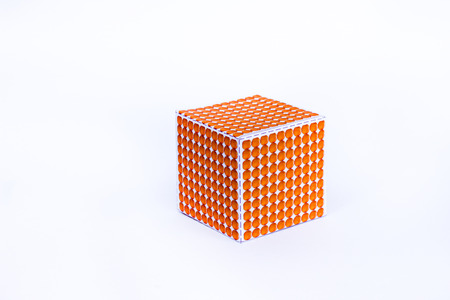 Montessori material , one thousand cube on white background , Golden Bead 1000 Cube