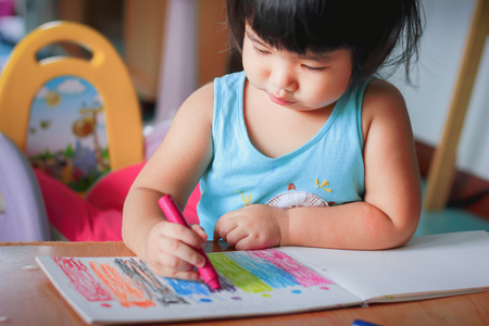 cute girl drawing with colourful crayon ,kids Coloring Imagens - 73845396