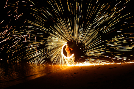 Man playing fire baton