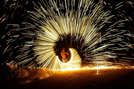 baton: Man playing fire baton