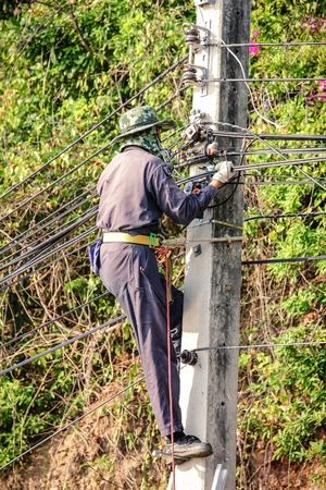 wireman: Electrician climb electric pole