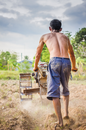 cultivator: Asian peasants plow with a tractor