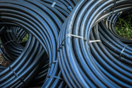 Telephone cable , Close-up of rolls of telecom IT cable tubing for internet telephone communications infrastructures.