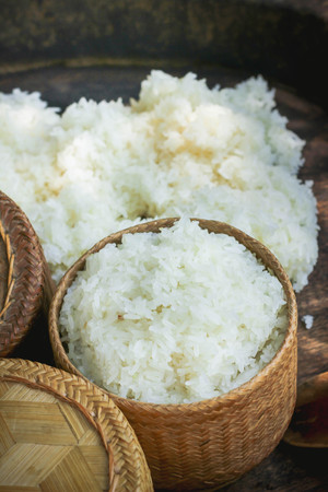 Sticky rice on wooden tray concreate background , Thailand ,Asia