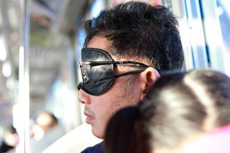 Asian men sleep on the train in Japan , Asian men sleep on the train in Japan with exhaustion.
