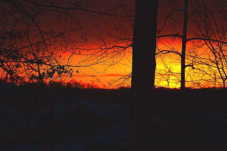 appeared: A dramatic sunset that appeared after a snowstorm. Stock Photo