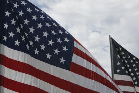 u s: close  tight shot of a Pair of U,S, Flags