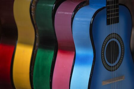 fret: Multiple Colorful Guitars Stock Photo