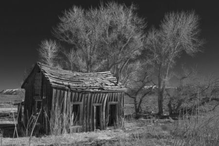 farm structures: Black and White of a rustic and delapidated old home. Stock Photo