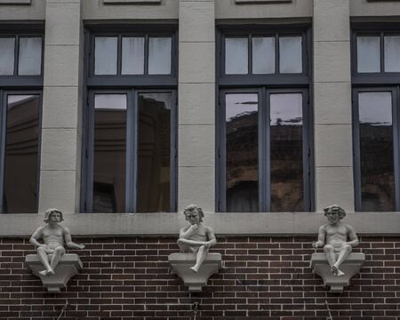 embellished: Building facade with windows and embellished with statuettes Stock Photo
