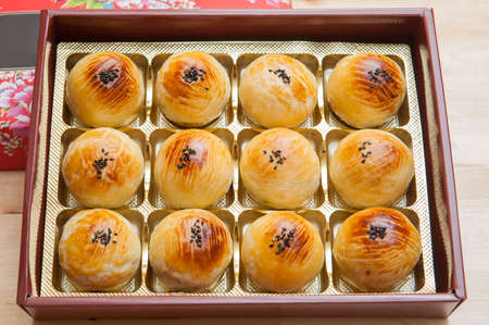 Chinese pastry or Moon cake, top view, Mooncake is a Chinese bakery product traditionally eaten during the Mid-Autumn Festival.