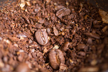 Coffee beans are ground into coffee powder by a grinder