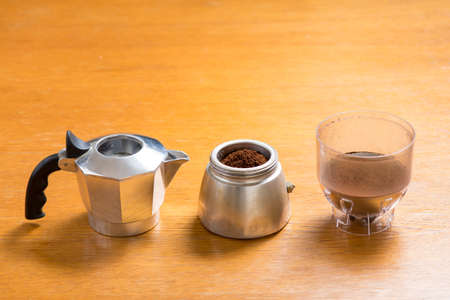 Moka pot and coffee beans and grinder