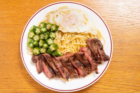 Steak Italian pasta (garlic, poached egg, okra, steak,  spaghetti)