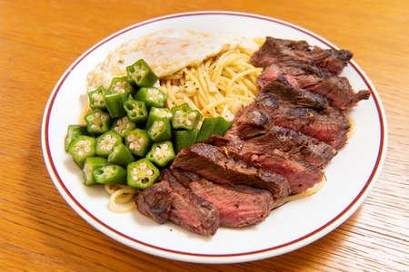 Steak Italian pasta (Garlic, poached egg, okra, steak with spaghetti)