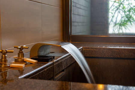 Bathtub and washbasin in hot spring soup house ( shower,  spa,  steam)