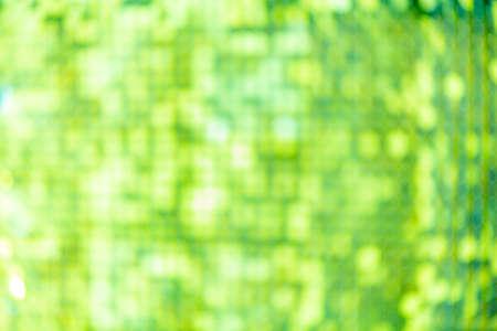 Abstract blur sequin dress colorful bokeh green light. Design backdrop. Disco color
