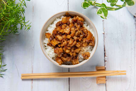 braised pork on rice is Minced pork served with pickles on top of steamed rice, street food