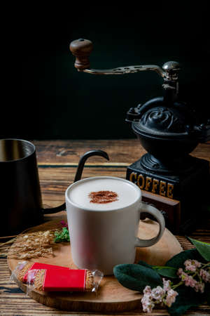 A cup of hot cocoa and coffee with biscuits in a leisurely afternoon tea