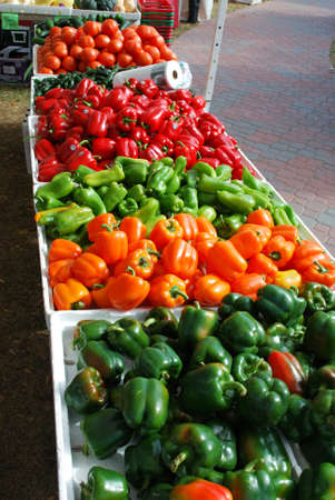 Peppers fill a table at the farmers market photo