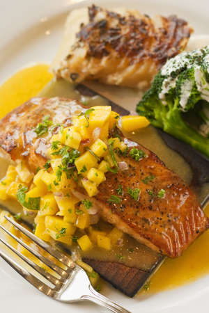 cedar plank cooked salmon with mango salsa,  brocccoli and potato