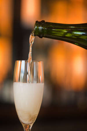 pouring French champagne, Cafe Luck, Santa Barbara, California, United States of America photo