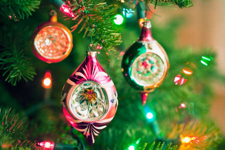 Christmas ornaments and lights on a Christmas tree Imagens