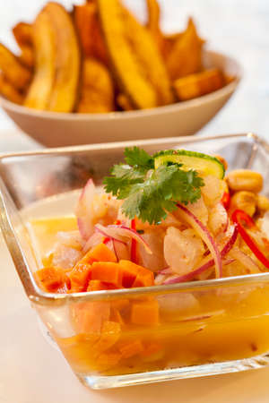 Ceviche Peruano with sweet fried potatoes Imagens
