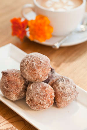 cinnamon and golden raisin beignets Imagens