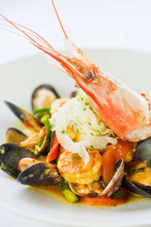 Asian-inflected paella with shrimp, mussels and clams Imagens