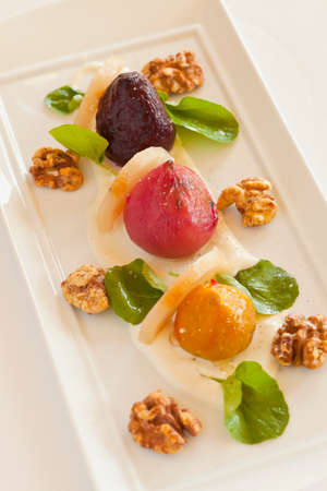 Organic vegan heirloom beets with Bosc pears, candied walnuts, watercress and goat cheese walnut dressing Imagens