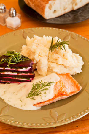organic salmon in dill sauce with mashed potatoes and beets layered with goat cheese and basil