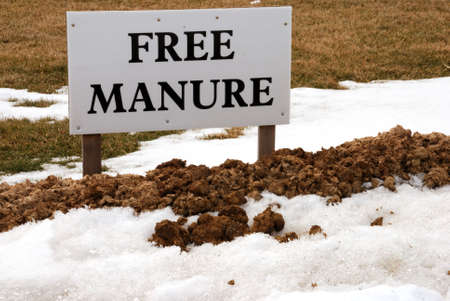 Sign speaks for itself.  Perfect advertisement? Horse manure ready for the taking.