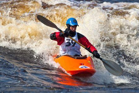 Kayak freestyle on whitewater