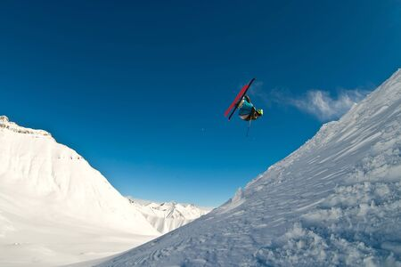 airborn: Skier flying in the air