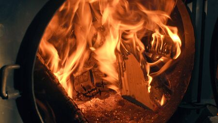 smolder: Wood burning in the stove. Fire close up.
