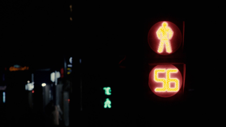 Close up of Moscow traffic light counting down in seconds on black background