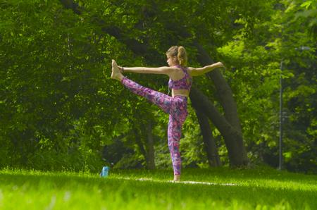 hasta: Young woman doing yoga exercises