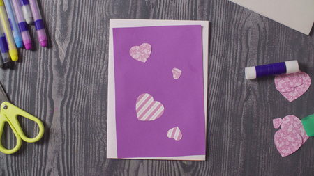 Greeting card and scissors on the table