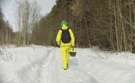 Ecologist walking in winter forest Stock Photo