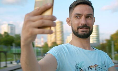 Portrait of the smiling man shooting selfie 版權商用圖片