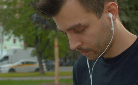 Portrait of a man listening to music Фото со стока