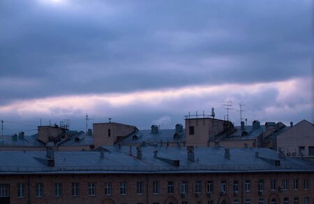 Dark cloudy sky over city buildings. Evening time, autumn. Sky background