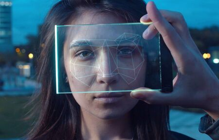 Futuristic Technological Face Scanning. Face scanner in the hand. Biometric Facial Recognition of young woman in the city