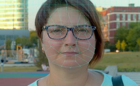 Futuristic Technological Face Scanning. Biometric Facial Recognition of young woman in the city. Video and animation. 版權商用圖片