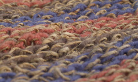 Extreme close up multicolored wool knitted fabric. Texture, textile background. Macro shooting